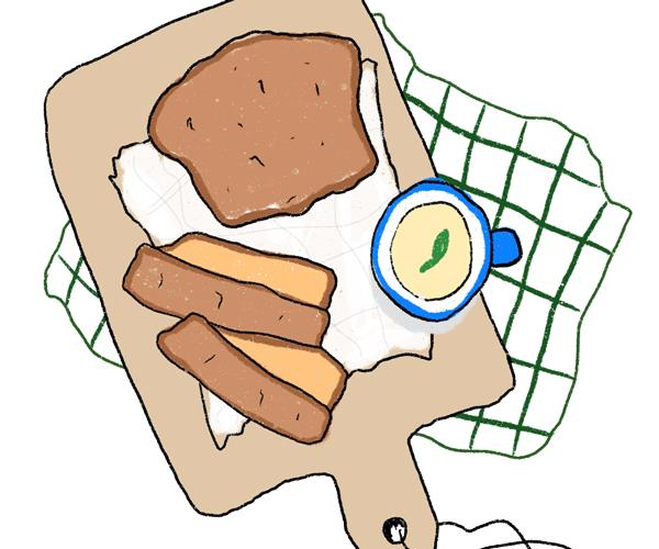 Illustration of sliced banana bread on a wooden chopping board, with a pot of butter, on a white and green checked tea towel.