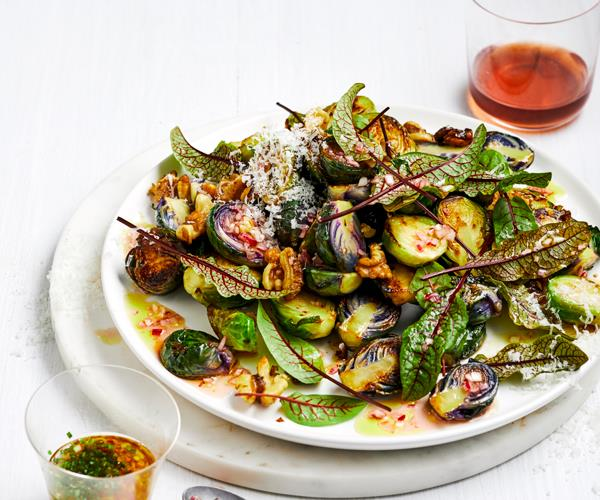 Salad of fried Brussels sprouts and sorrel leaves on a white plate