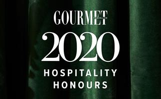 A emerald-green velvet background, with white text overlaid that reads Gourmet Traveller 2020 Hospitality Honours
