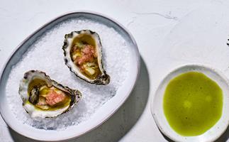 Raes on Wategos' oysters with lemon-aspen vinegar, anise-myrtle oil and finger lime