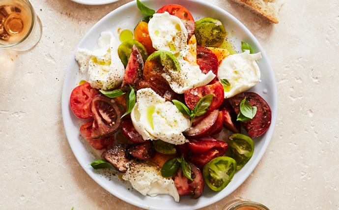 Insalata of tomato, mozzarella and basil with anchovies