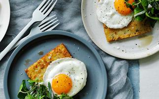 Hash browns with eggs fried in olive oil and herb salad recipe