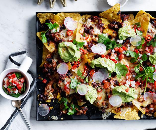 """**[Pulled chicken and black bean nachos](https://www.gourmettraveller.com.au/recipes/browse-all/pulled-chicken-and-black-bean-nachos-12387
