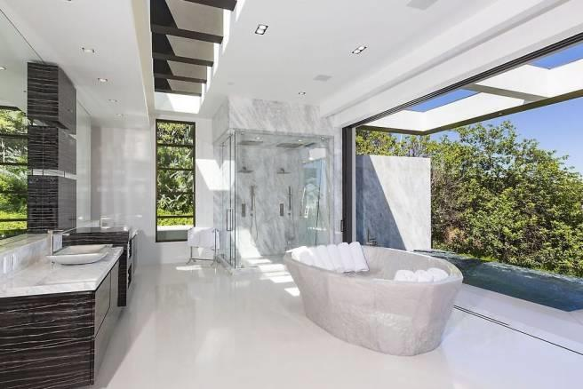 Another bathroom features clean and simple lines with marble accents.