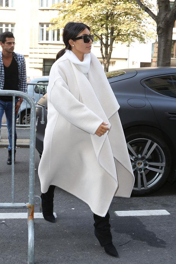 Sporting a luscious white coat and turtleneck on September 24.