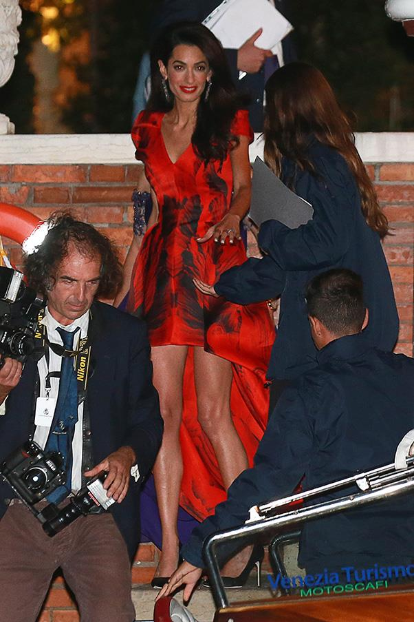 Alamuddin looked sensational in a show-stopping scarlet gown by Alexander McQueen for her rehearsal dinner.