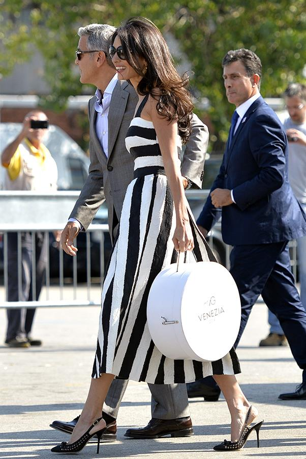 The genetically-blessed couple stepped out on Friday before their rehearsal dinner, with Alamuddin looking polished in a striped black and white Dolce & Gabbana dress.
