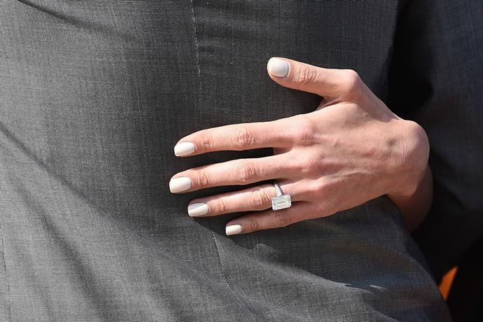 Alamuddin's seven-carat diamond engagement ring was designed in part by Clooney. The ring features ethically-mined stones in an emerald-cut design with two tapered baguettes set in platinum.
