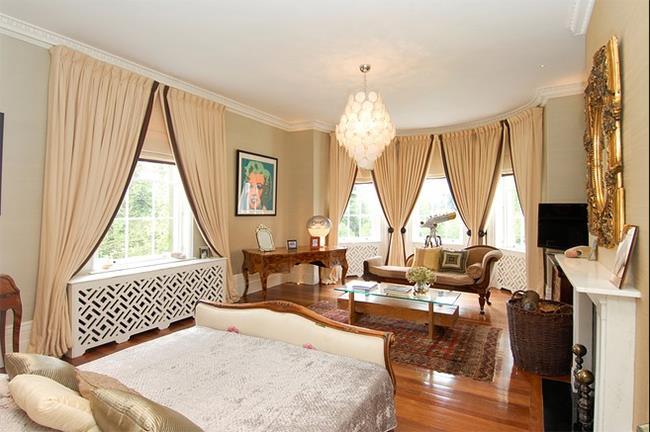The master suite features a fireplace, sitting area and fitted dressing room.