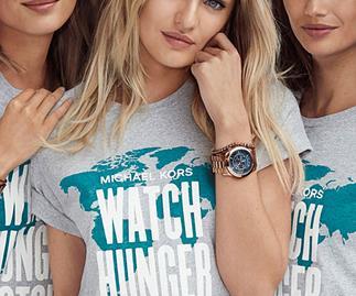 Models wearing Micheal Kors Watch Hunger Stop tshirts