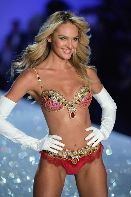 <strong>2013: Royal Fantasy Bra</strong> <br>Angel: Candice Swanepoel <br>Value: $10,000,000 <br><br>The 2013 fantasy bra features 4,200 gems elaborately set in 18-carat gold with a show stopping 52 carat pear-shaped ruby.