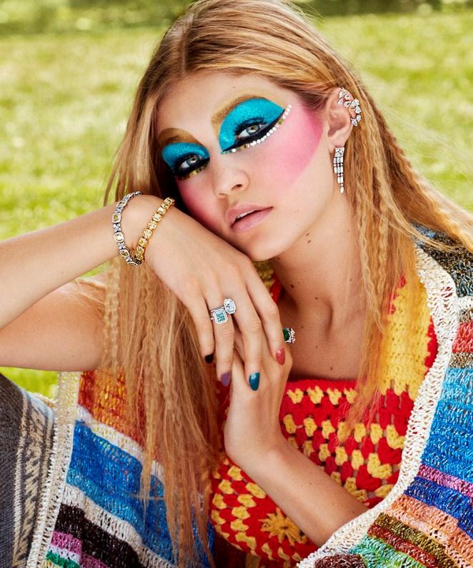 Saint Laurent shawl; Repossi ear cuff; Tiffany & Co. earring, bracelets and rings.