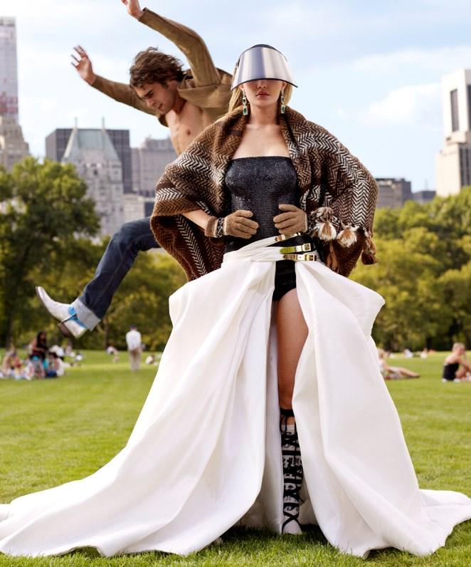 Gigi wears El Inti poncho; Atelier Versace bodysuit and skirt; Alexandre Reza earrings. <br><br>Gus wears Berluti blazer.