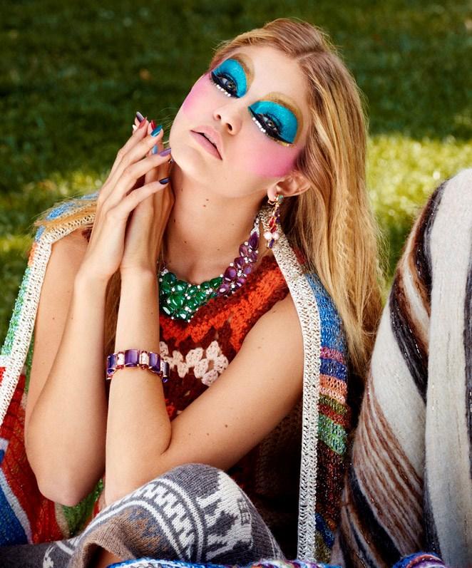 Saint Laurent shawl; Bulgari earrings, necklace and bracelet.