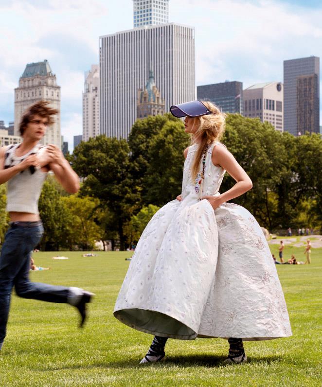 Gigi wears Christian Dior haute couture dresses. <br><br>Gus wears The Elder Statesman vest.