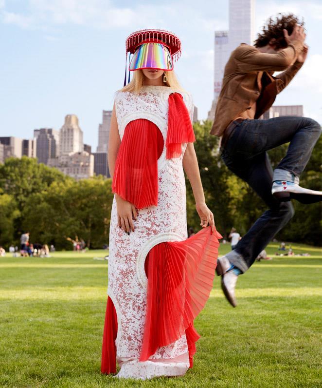Gigi wears Vionnet Demi-Couture dress; Threads of Peru hat; Alexandre Reza earrings. <br><br>Gus wears Berluti blazer.