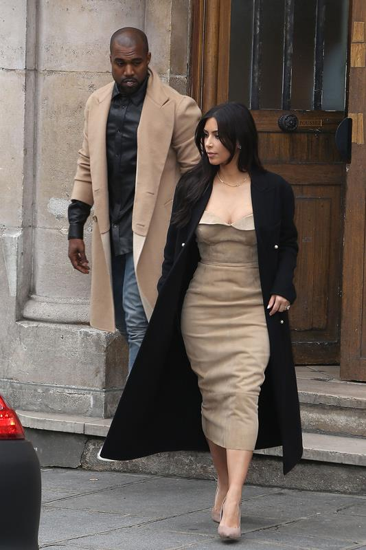 <strong>What:</strong> Just days before their wedding, Kim and Kanye step out in coordinating camel – Kim in an Ermanno Scervino bustier dress, Kanye in a matching coat. <br><strong>When:</strong> May 2014 <br><strong>Where:</strong> Leaving Maison Martin Margiela in Paris