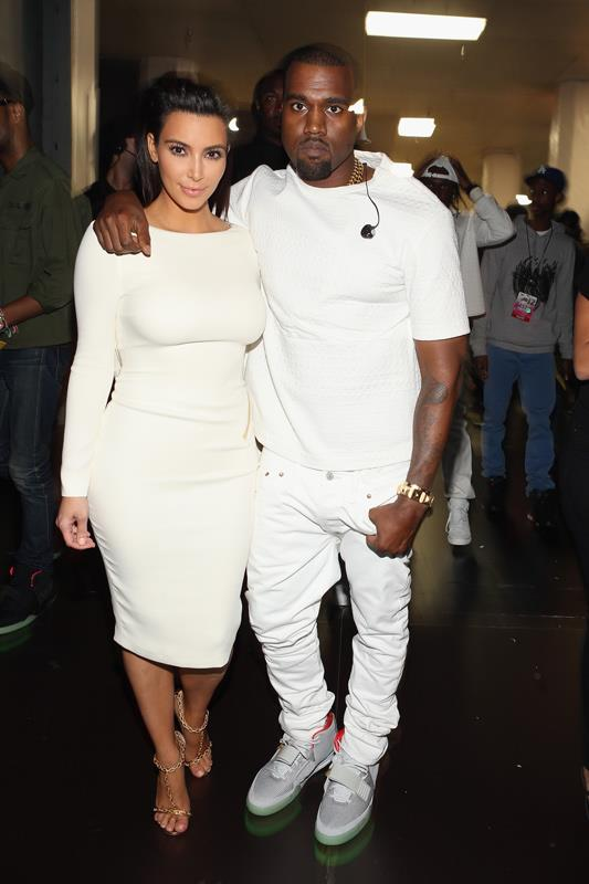 <strong>What:</strong> Kim in a sexy backless white Tom Ford dress, Kanye in a white T-shirt and jeans. <br><strong>When:</strong> July 2012 <br><strong>Where:</strong> The 2012 BET Awards in LA