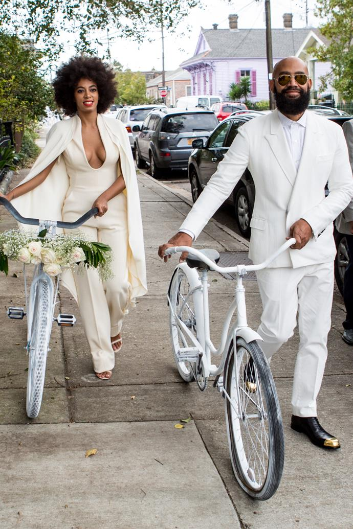 On the big day, Knowles eschewed tradition in an ivory Stéphane Rolland jumpsuit, with the couple arriving on matching white bicycles. Ferguson's bicycle got a flat and the pair had to walk their bikes to the church.
