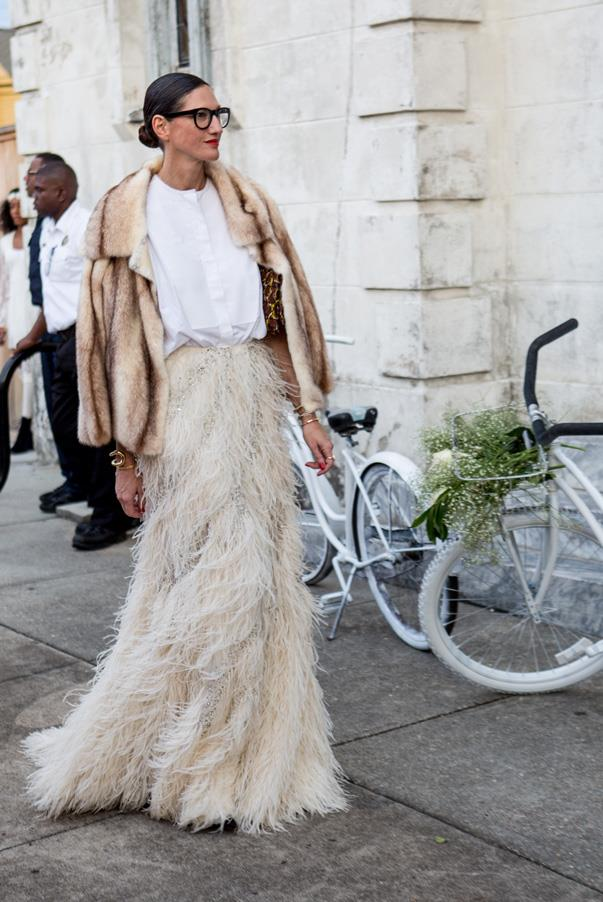 Although white is usually reserved only for the bride, the wedding guests arrived in a multitude of white, ivory and cream. Jenny Lyons, creative director of J.Crew absolutely nailed the dress code in a feathered maxi-skirt, fur coat and crisp, white button up combination.