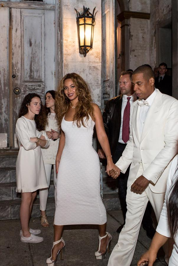 Beyoncé wore a curve-hugging Torn by Kobo dress with white shoes for the ceremony and reception, with husband Jay Z in a dapper, sophisticated tuxedo.