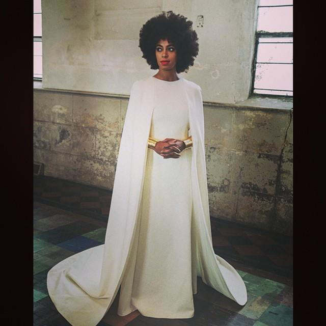 "The crème-de-la crème of wedding dresses, Solange oozed effortless elegance in a Humberto Leon for Kenzo caplet gown and gold, Lady Grey cuffs. The pair were married in the Holy Trinity Church in the Bywater area of New Orleans. <br>Photo credit <a href=""http://instagram.com/p/vfBjPYJQ4f/?modal=true""> @Mindykaling</a>."