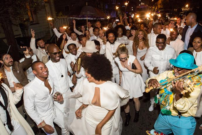 Post ceremony, the wedding guests danced down the French Quarter waving sparklers with performances by friends of the couple – Kelela, Questlove, and Kindness.