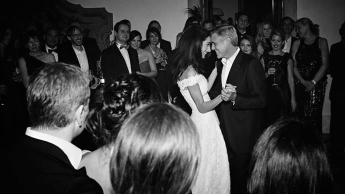 New pictures of the happy couple at their wedding have emerged, including images of Mr. and Mrs. Clooney's first dance.