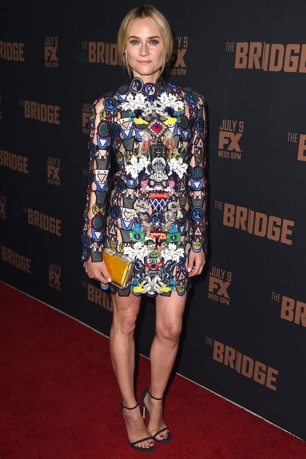 <strong>Diane Kruger in Mary Katrantzou</strong> <br><br>British designer Mary Katrantzou had one of the most talk about collections of the Fall 2014 season. Naturally, Kruger, who is never one to shy away from a daring look, was able to snap up this bold mini dress soon after it showed in London.