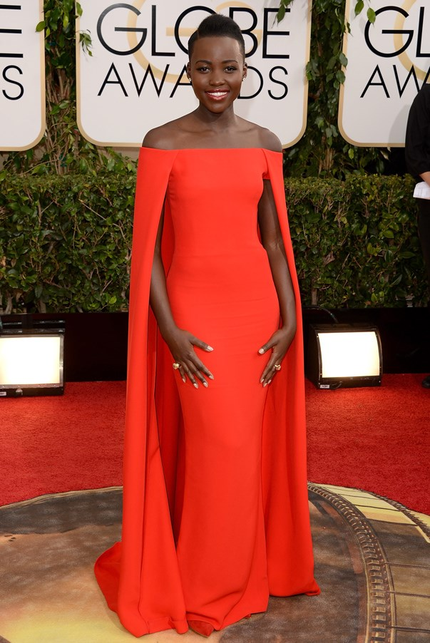 <strong>Lupita Nyong'o in Ralph Lauren</strong> <br><br>Lupita Nyong'o was undoubtedly the break-out star of 2014, with every red-carpet look more flawless than the last thanks to the help of super stylist <strong>Micaela Erlanger</strong>. Nyong'o's red caped Ralph Lauren gown was a true fashion moment that will be hard to forget.