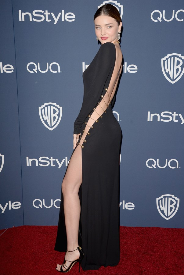 <strong>Miranda Kerr in Pucci</strong> <br><br>As a former Victoria's Secret Angel, the Aussie model knows a thing or two about being sexy – and manages to achieve this look even when mostly covered up. Case in point: Kerr sizzled in this long-sleeve backless Pucci gown with a side slit held together by several thin gold chains.
