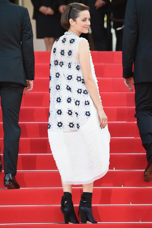 <strong>Marion Cotillard in Dior </strong> <br><br>While most actresses attending a Cannes Film Festical premier go for elaborate gowns ranging from old glamour to sultry, Cotillard – who has her pick of any Dior evening gown – opted for something unexpected. The French actress was a sartorial standout in a sea of fishtail gowns with this mullet-hem dress, adding a bit of punk edge with slick hair, a chain link necklace and ankle booties.