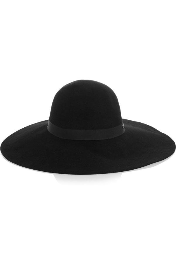 """<a href=""""http://www.net-a-porter.com/product/512734/Maison_Michel/blanche-wide-brim-rabbit-felt-hat """">Maison Michel hat</a>, $450"""