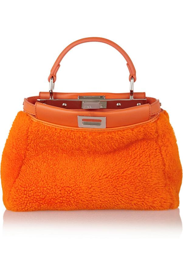 "<a href=""http://www.net-a-porter.com/product/468910/Fendi/peekaboo-mini-leather-trimmed-shearling-tote"">Fendi Peekaboo shearling tote</a>, $4380"