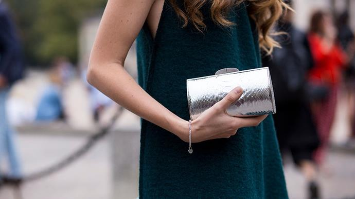 <strong>A metallic clutch </strong> <br>Don't just let your inner magpie out at night. Worn by day, a flash of silver will elevate even the most minimal daywear into something dramatic.