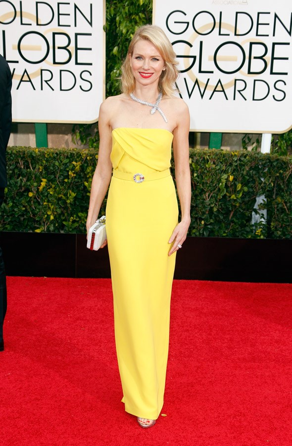 """<strong>Naomi Watts in Gucci</strong> <br><br>""""Naomi Watts is having a big moment on-screen and off. She is incredible in <em>St Vincent </em>and in <em>Birdman </em>and I love this simple yellow Gucci gown paired back with a stunning Bulgari Serpenti necklace."""" <br>– Kellie Hush, Editor-In-Chief"""