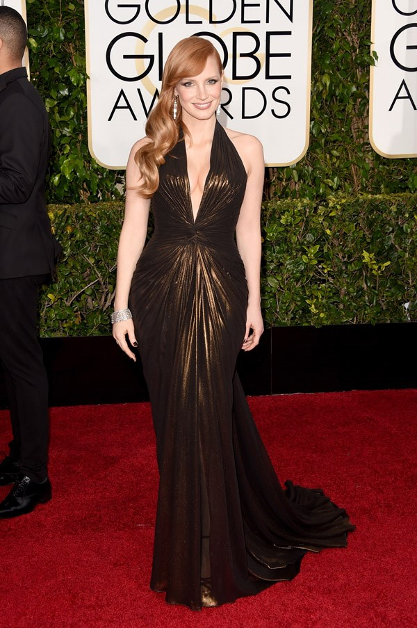 """<strong>Jessica Chastain in Atelier Versace</strong> <br><br>- """"Did all the hair stylists in Hollywood get together for a pre-Globes pow-wow and decide to give all our favourite a-list ladies the same 'do? I guess the important thing is it works with the Versace which is both an unexpected choice for Chastain and smokin'. So it's a win."""" <br>- Clare Maclean, Fashion Features Director"""