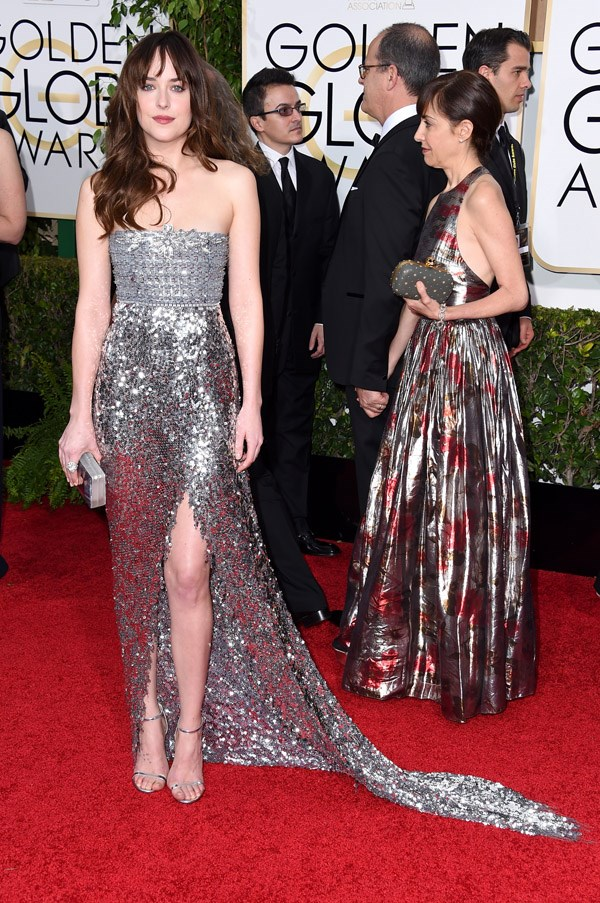 """<strong>Dakota Johnson in Chanel</strong> <br><br>""""50 Shades of Chanel silver! I adore Dakota Johnson's strapless Chanel Haute couture dress. The detail on the bodice and the tigh-high split are tres chic!"""" <br>– Kellie Hush, Editor-In-Chief"""