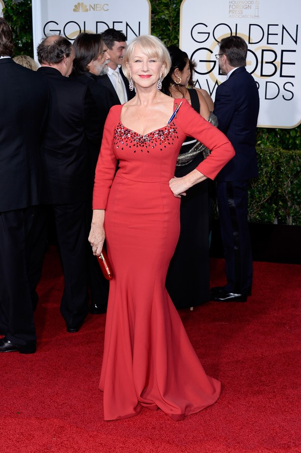 """<strong>Helen Mirren in Dolce & Gabbana</strong> <br><br>""""You're a minx who thinks and I worship the ground you swish across in this dress."""" <br>- Tracey Withers, Acting Beauty Director"""