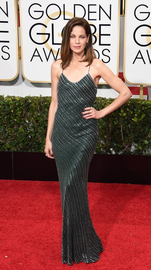 """<strong>Michelle Monaghan in Jason Wu</strong> <br><br>""""Michelle's inky green bias-cut slip really is a piece of 90s minimalist perfection. And I love the hair restraint. No oversized curls here."""" <br>– Eliza O'Hare, Associate Editor"""