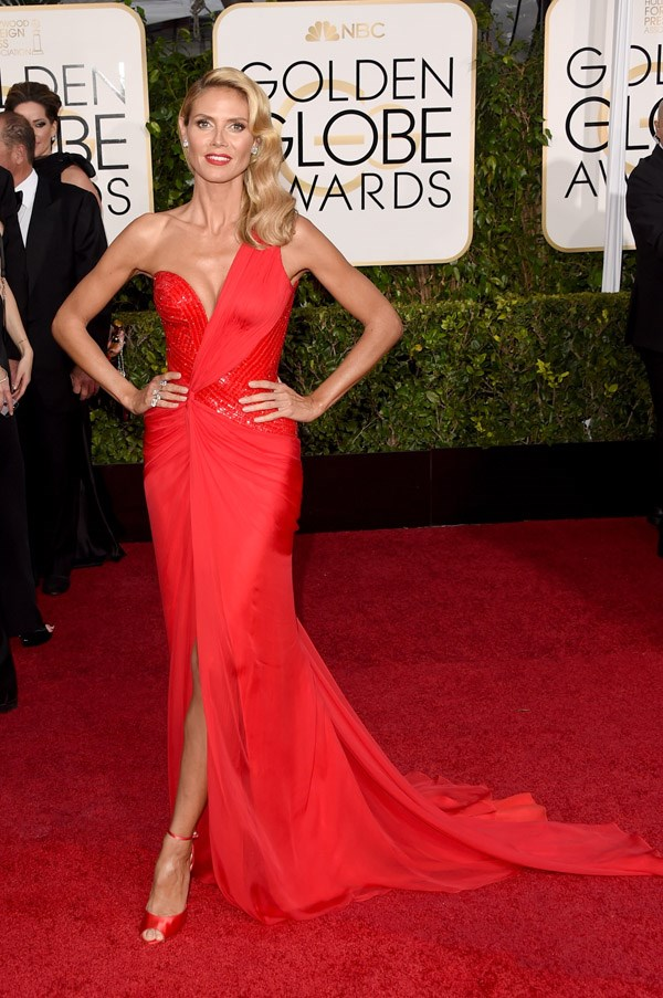 """<strong>Heidi Klum in Atelier Versace</strong> <br><br>""""It's hard to be sure, but I <em>think </em>Heidi Klum likes red …"""" <br>– Jessica Matthews, Deputy Chief Subeditor"""