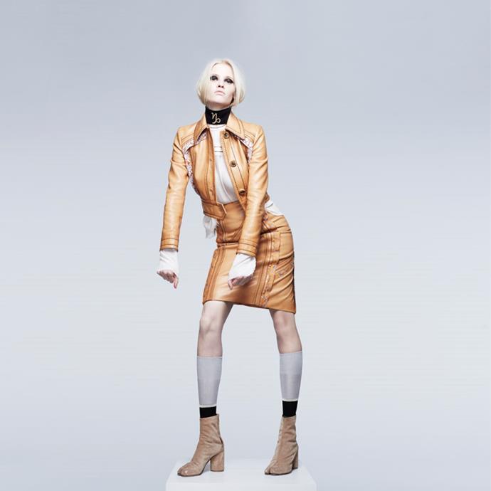 <strong>CAPRICORN</strong> <BR><em>Lara Stone</em> in <em>Prada</em> jacket, blouse, skirt and socks; Maison Martin Margiela boots.