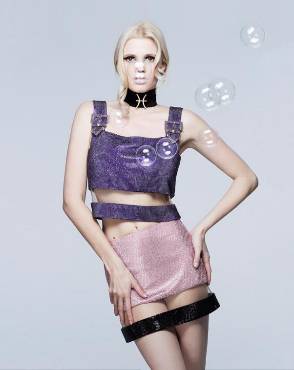 <strong>PISCES</strong> <BR><em>Lara Stone </em>in <em>Versace </em> top and skirt.