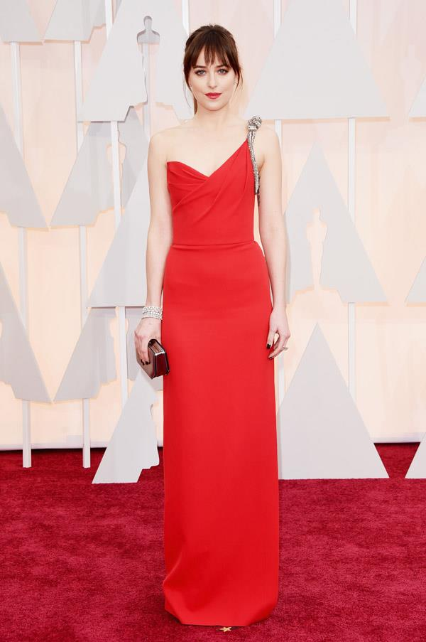 Saint Laurent has really stepped up its red carpet appearances lately, with talk-of-the-town Dakota Johnson choosing an incredible red column gown for the big night. Matching lips finished off the look.