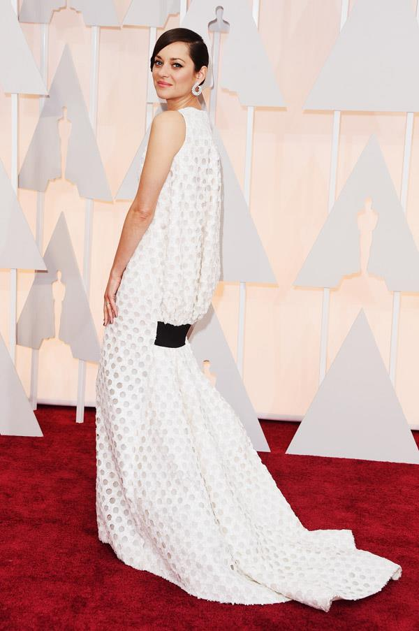 We absolutely LOVE this Christian Dior dress on Marion Cotillard, but we do feel like we've seen her in similar looks before. Luckily, she looks so good in it that we can't complain too much.