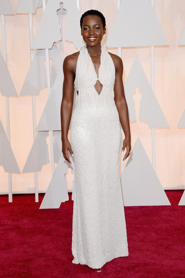 Lupita Nyong'o's custom Calvin Klein dress is so breathtaking, we can barely take it. Oh, in case you're wondering, there's 6,000 pearls on that dress.