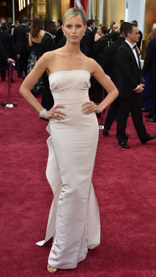 We're not entirely sure why Karolina Kurkova is attending the Oscars, but she looks beautiful regardless, opting for a pretty pastel pink Marchesa gown with ruffled back detailing.
