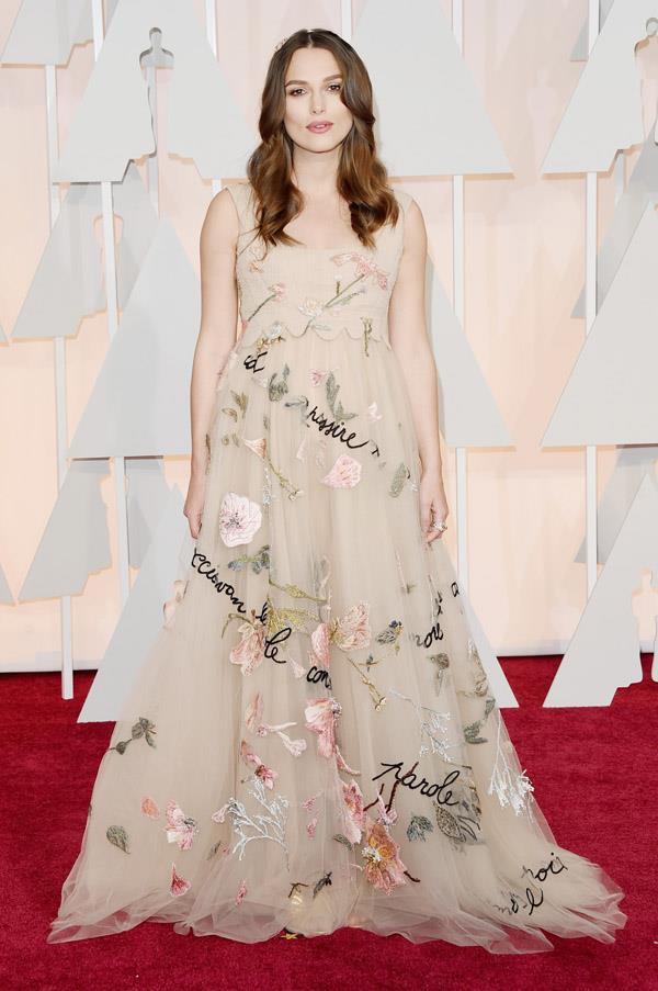 A pregnant and glowing Keira Knightley looks ethereal in this Valentino Couture gown.