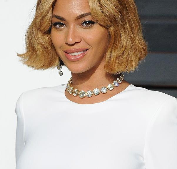 Beyonce wears a white dress on the red carpet