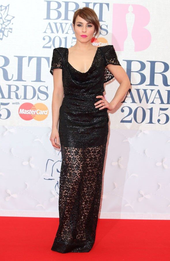 Actress Noomi Rapace in a black lacy number.